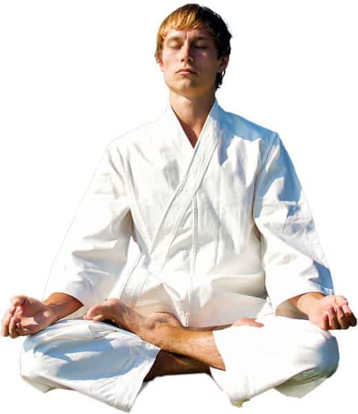 Martial Arts Lessons for Adults in Bossier City LA - Young Man Thinking and Meditating in White