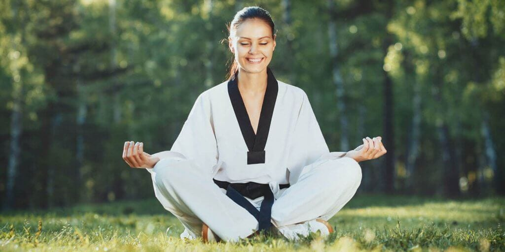 Martial Arts Lessons for Adults in Bossier City LA - Happy Woman Meditated Sitting Background