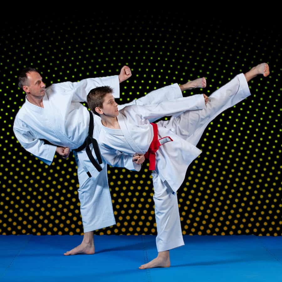 Martial Arts Lessons for Families in Bossier City LA - Dad and Son High Kick
